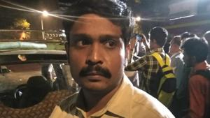 Mohommad Akhtar Ansari (39), a taxi driver, whose vehicle was crushed when a slab of the overbridge near Mumbai's CST collapsed on Thursday evening.(HT PHOTO)