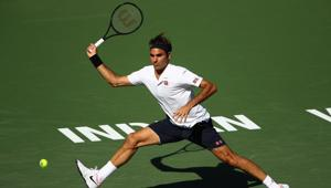 Roger Federer of Switzerland plays a forehand against Kyle Edmund at the Indian Wells.(AFP)