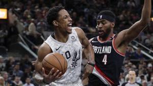 San Antonio Spurs guard DeMar DeRozan (10) drives around Portland Trail Blazers forward Maurice Harkless (4) during a NBA match.(AP)
