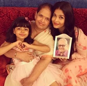 Aishwarya Rai and Aaradhya Bachchan pose with the actor's mom and her late father Krishna's photo.