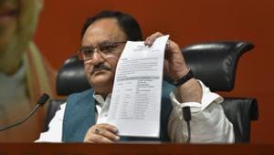 Union minister and BJP leader JP Nadda shows the first list of candidates for the upcoming Lok Sabha elections, at party office in New Delhi on March 21.(PTI Photo)