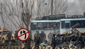 Security personnel carry out the rescue and relief works at the site of suicide bomb attack at Lathepora Awantipora in Pulwama district of south Kashmir, Thursday, February 14, 2019. At least 30 CRPF jawans were killed and dozens other injured when a CRPF convoy was attacked.(PTI File Photo)