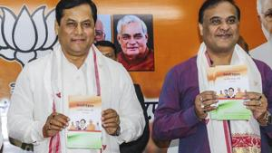 File photo of Assam Chief Minister Sarbananda Sonowal flanked by NEDA Chairman Himanta Biswa Sarma (right).(PTI File)