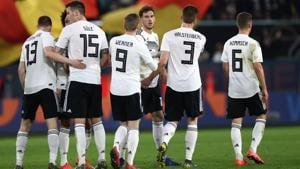 Germany's midfielder Leon Goretzka (C) celebrates with his teammates during their friendly match against Serbia.(AFP)