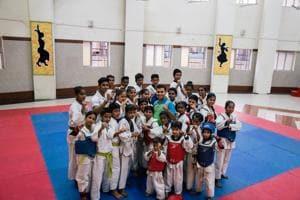 In a Chembur slum, onetime resident and taekwondo champ Jaydeep Kadam gives kids a fighting chance at success(HT PHOTO)