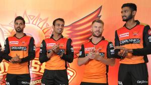 Sunrisers Hyderabad cricket team vice captain Bhuvaneshwar Kumar (L) and teammate David Warner (2R) pose with other players during a press conference in Hyderabad(AFP)