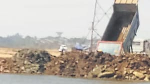 Debris dumping in Bhendkhal in Uran wetlands is slowly leading to reclamation of two water bodies. The image was sent to the state mangrove committee by a panel member.(HT Photo)