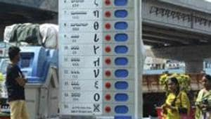 Vijayawada: Pedestrians walk past a replica of Electronic Voting Machine (EVM) installed by the Election Commission of India to create awareness about voting at Benz circle, in Vijayawada, Saturday, March 16, 2019.(PTI)