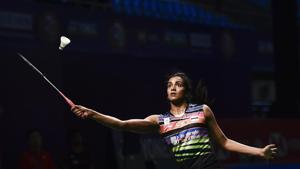 New Delhi: Indian badminton player PV Sindhu plays a shot against Hong Kong's Deng Xuan during the second round of women's singles badminton match at Yonex Sunrise India Open 2019(PTI)