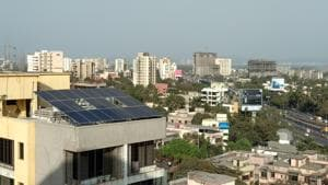 The 7.15 kilowatt-power (kWp) solar power plant installed at the society's rooftop.(HT Photo)