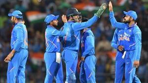 Virat Kohli (R) celebrates with Mahendra Singh Dhoni (C) and teammates.(AFP)