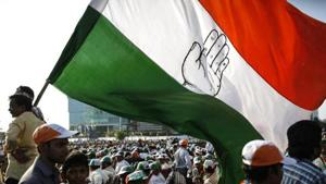 Supporters of Congress holding a huge flag attend an election campaign rally.(Reuters file photo)