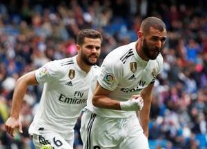 Real Madrid's Karim Benzema celebrates scoring their second goal(REUTERS)