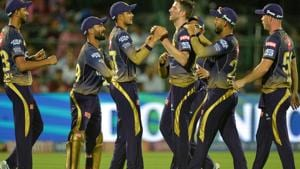 Kolkata Knight Riders cricketers celebrate the dismissal of Rajasthan Royals cricketer Jos Buttler.(AFP)