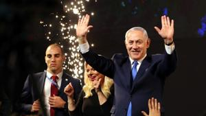Israeli Prime Minister Benjamin Netanyahu and his wife Sara react as they stand on stage following the announcement of exit polls in Israel's parliamentary eJerusalemlection at the party headquarters in Tel Aviv, Israel April 10, 2019. REUTERS/Ammar Awad(REUTERS)