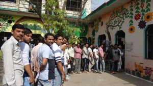Voters outside a polling booth in Meerut in Uttar Pradesh on Thursday.(HT PHOTO)