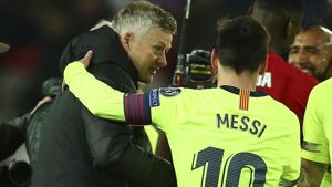 Barcelona's Lionel Messi, right, embraces to Manchester United coach Ole Gunnar Solskjaer at end of the Champions League quarterfinal, first leg, soccer match between Manchester United and FC Barcelona at Old Trafford stadium(AP)