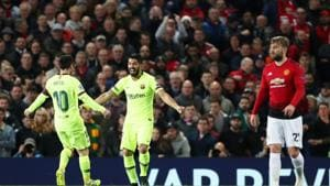 Barcelona's Luis Suarez celebrates scoring their first goal with Lionel Messi and Manchester United's Luke Shaw reacts(Action Images via Reuters)