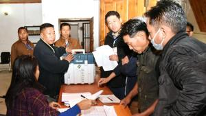 Polling officials collect the Electronic Voting Machine (EVM) and other items for use in the General Elections-2019, at the distribution centre, in Kohima on Wednesday, April 10, 2019. The lone Lok Sabha seat in the state is voting on April 11.(ANI)