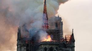 Smoke billows as fire engulfs the spire of Notre Dame Cathedral in Paris, France April 15, 2019. REUTERS/Benoit Tessier(REUTERS)