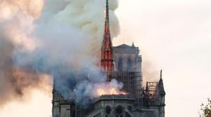 Smoke billows as fire engulfs the spire of Notre Dame Cathedral in Paris, France.(REUTERS)