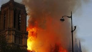 On Monday, YouTube's software mistakenly labeled the plumes of smoke in Paris as footage from 2001, triggering the panel below the video.(AP)