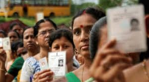 Women show their voter identity cards as they stand in a queue before casting their votes during the first phase of the general elections at a polling station in Agartala, Tripura on April 11, 2019.(PTI)