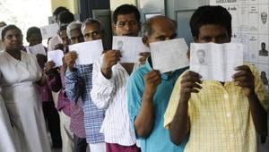 Inmates of the Institute of Mental Health, stands in a queue to cast their vote for the first time in history of the Indian Election in Chennai on Thursday.(ANU photo)