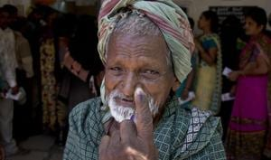 An Indian old man shows the indelible ink mark on his index finger after casting vote at a polling booth during the first phase of general elections in Hyderabad, India Thursday, April 11, 2019.(AP file photo)
