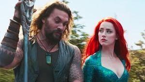 Amber Heard and Jason Momoa in a still from Aquaman.