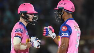 Rajasthan Royals batsman Riyan Parag (R) and captain Steve Smith touch gloves.(AFP)
