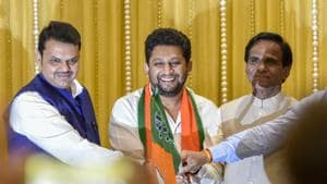 Sujay Vikhe Patil joins BJP in the presence of Maharashtra chief minister Devendra Fadnavis and BJP state president Raosaheb Danve in Mumbai on March 12.(HT FILE)
