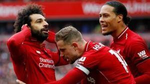 Liverpool's Mohamed Salah celebrates scoring their second goal with Jordan Henderson and Virgil van Dijk.(REUTERS)