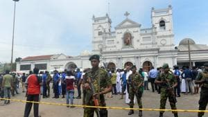Sri Lankan security personnel keep watch outside the church premises following a blast at the St. Anthony's Shrine in Kochchikade, Colombo on April 21, 2019.(AFP)