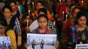 Teachers hold candles as they pray for the victims of Sri Lanka's bomb blasts, at a school in Ahmedabad, April 22(REUTERS)