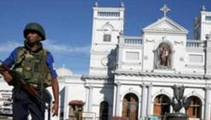 A security officer stands in front of St Anthony's shrine in Colombo, after bomb blasts ripped through churches and luxury hotels on Easter, in Sri Lanka on Monday.(REUTERS)
