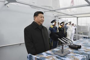 Chinese president Xi Jinping reviews a naval parade with Chinese and foreign military ships held in commemoration of the 70th anniversary of the Chinese People's Liberation Army (PLA) Navy in the sea near Qingdao in eastern China's Shandong Province, Tuesday, April 23, 2019.(AP photo)
