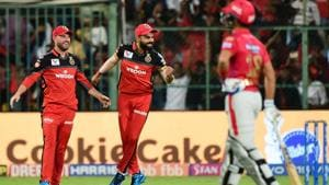 Bengaluru: RCB Skipper Virat Kohli and AB de Villiers celebrate after fall of a wicket of KXIP batsman during the Indian Premier League 2019 (IPL T20) cricket match between Royal Challengers Bangalore (RCB) and Kings XI Punjab (KXIP) at Chinnaswamy Stadium in Bengaluru, Wednesday, April 24, 2019.(PTI)