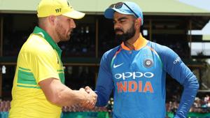 Aaron Finch of Australia and Virat Kohli of India take part in the coin toss.(Getty Images)