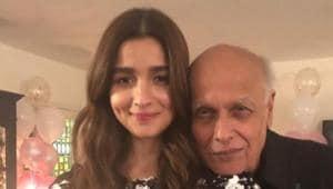 Alia Bhatt with her father Mahesh Bhatt on her birthday.(Twitter)