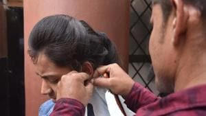 NEET 2019 analysis: A students removing her earing at a NEET exam centre at Kendriya Vidyalaya no 2, in Bhopal on Sunday.(Mujeeb Faruqui/HT photo)