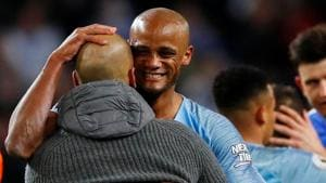 Manchester City manager Pep Guardiola celebrates with Vincent Kompany after the match(Action Images via Reuters)