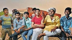 Truck drivers talk about their voting rights at the Sanjay Gandhi Transport Nagar in New Delhi. The country has an estimated nine million goods vehicle drivers.(Raj K Raj/HT PHOTO)