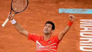 Serbia's Novak Djokovic celebrates after defeating Greece's Stefanos Tsitsipas during their ATP Madrid Open final tennis match at the Caja Magica in Madrid on May 12, 2019.(AFP)