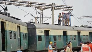 Members of the Accident Relief Staff in action as the second last coach of an EMU passenger train derailed in the morning, at Ghaziabad Railway Station, in Ghaziabad, India, on Thursday(Sakib Ali / Hindustan Times)