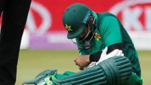 Pakistan's Imam-ul-Haq raects after being hit by the ball(Action Images via Reuters)