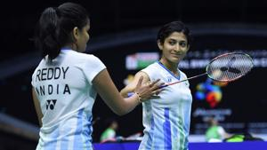 Ashwini Ponnappa (R) and N.Sikki Reddy react after winning a point against Chow Mei Kuan and Lee Meng Yean.(AFP)