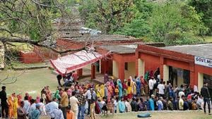 People wait outside a polling station at Udhampur, about 75 km from Jammu, on April 18. Jammu and Kashmir voted in five phases in the seven-phased general elections.(Nitin Kanotra /HT PHOTO)