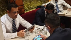 ICC World Cup 2019:Dhoni playing PUBG with Chahal at the airport? Fans certainly think so