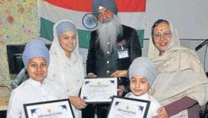 India's high commissioner to the UK Ruchi Ghanshyam (R) and president of Sikh Council, Wales, Gurmit Randhawa honouring children for reciting 'shabads' at an event in Cardiff.